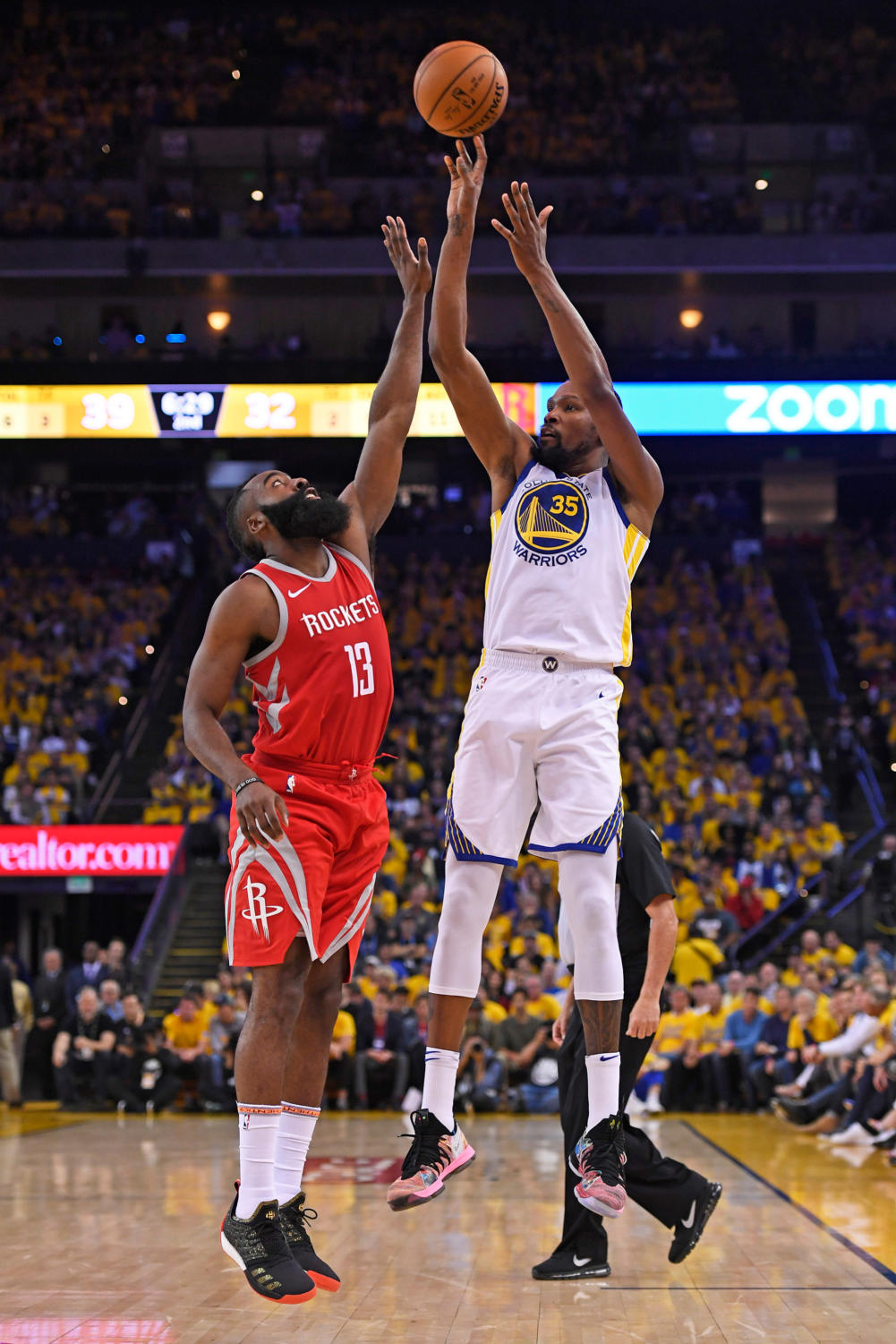 Golden State Warriors' Kevin Durant (35) shoots over Houston Rockets' James Harden (13) during the second quarter of Game 3 of the NBA Western Conference finals on May 20 at Oracle Arena in Oakland, Calif. (Jose Carlos Fajardo/Bay Area News Group/TNS)