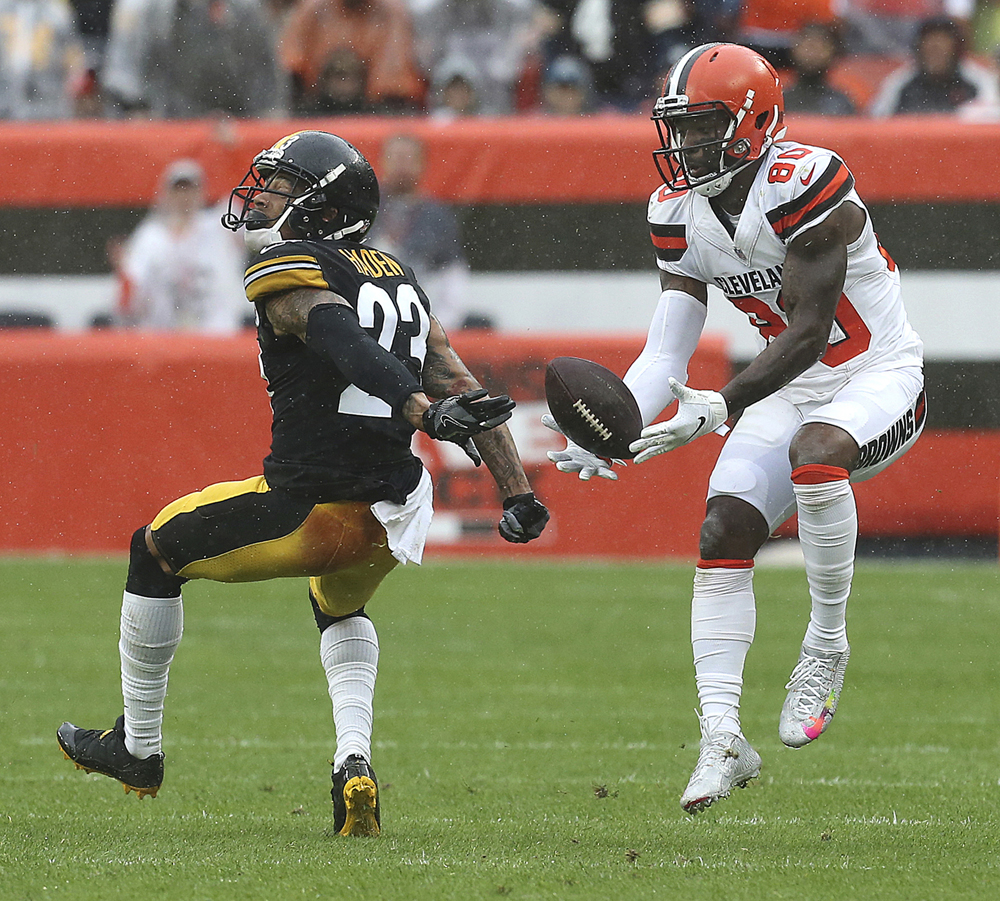 Cleveland Browns' Jarvis Landry makes a first quarter catch behind Pittsburgh Steelers' Joe Haden on Sept. 9 in Cleveland. The game ended in a 21-21 tie.  Phil Masturzo/Beacon Journal/TNS