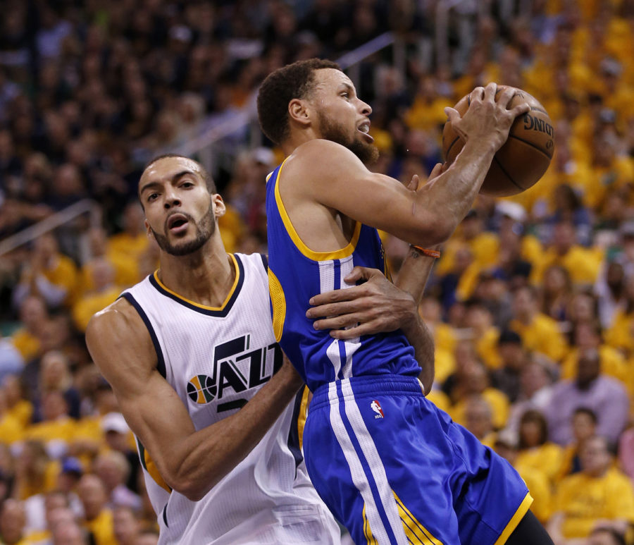 Utah Jazz's Rudy Gobert (27) grabs Golden State Warriors' Stephen Curry (30) after a foul was called against the Warriors in the second quarter of Game 4 of the NBA Western Conference semifinals in Salt Lake City on May 8, 2017.