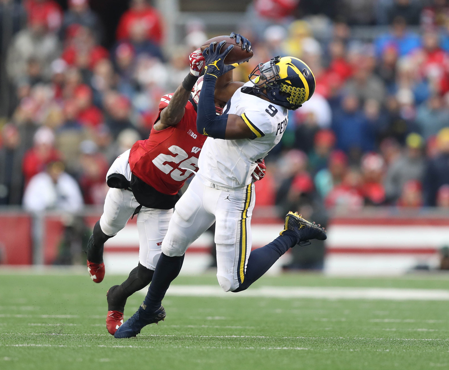 Michigan's Donovan Peoples-Jones makes a catch against Wisconsin during second quarter action Nov. 18, 2017, at Camp Randall Stadium in Madison, Wisconsin. Wisconsin won 24-10.  Kirthmon F. Dozier/Detroit Free Press/TNS Matt Freed/Pittsburgh Post-Gazette/TNS