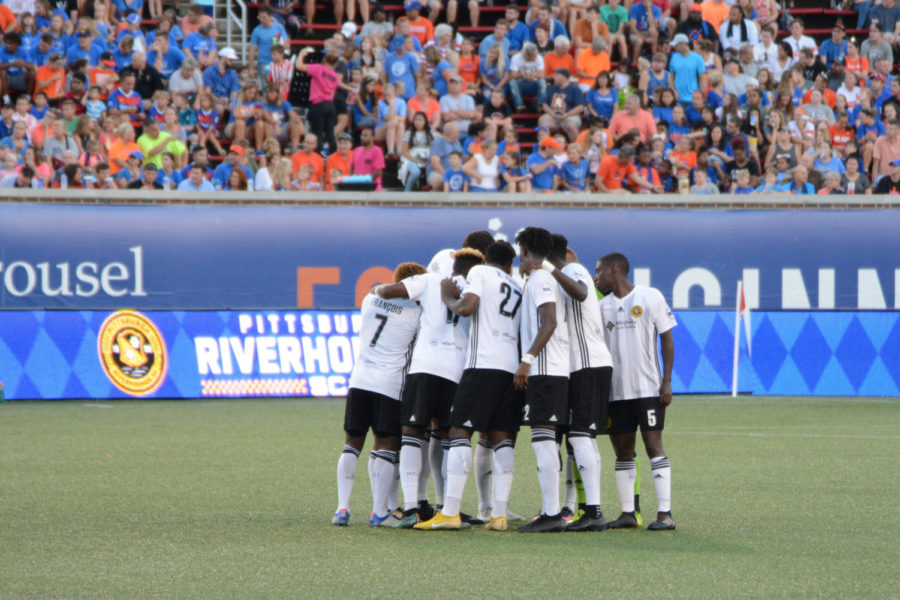 The Pittsburgh Riverhounds in a huddle during a match against Cincinnati FC at Nippert Stadium in Cincinnati on Sept. 1.  (Image via Wikimedia Commons)