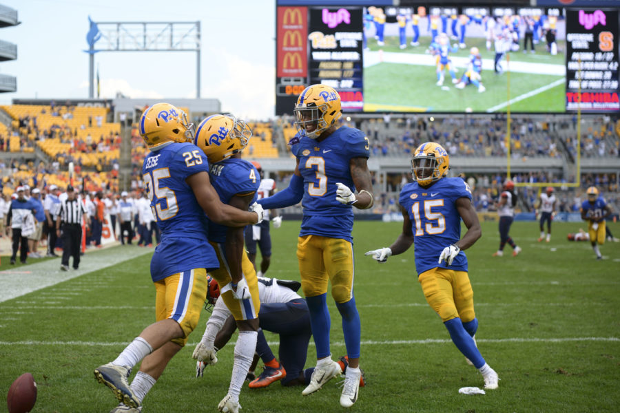 Pitt%27s+defensive+line+celebrates+redshirt+sophomore+Therran+Coleman%27s+overtime+interception+against+Syracuse+Saturday+afternoon.