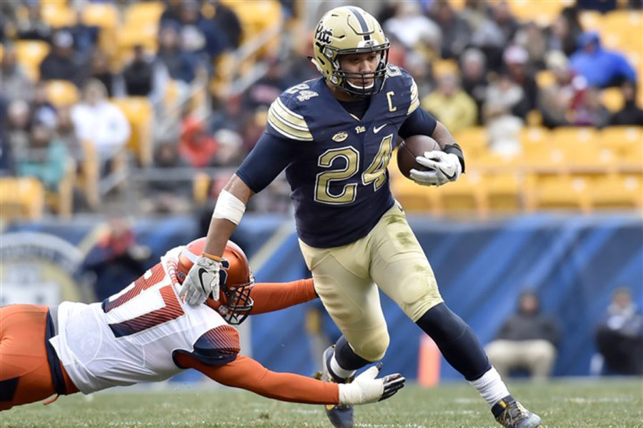 Pitt%27s+James+Conner+evades+Syracuse%27s+Ted+Taylor+in+the+second+quarter+Nov.+26%2C+2016%2C+at+Heinz+Field.+Pitt+won%2C+76-61.
