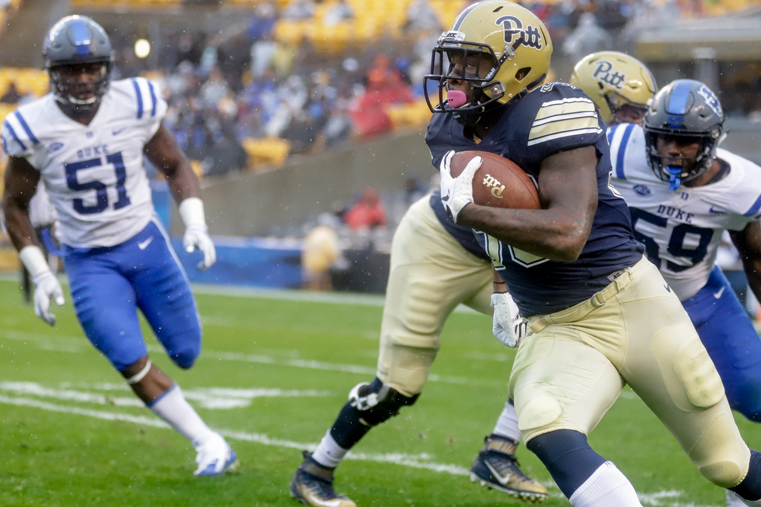 Senior running back Qadree Ollison (30) carries the ball at Pitt's 54-45 victory over Duke on Saturday.