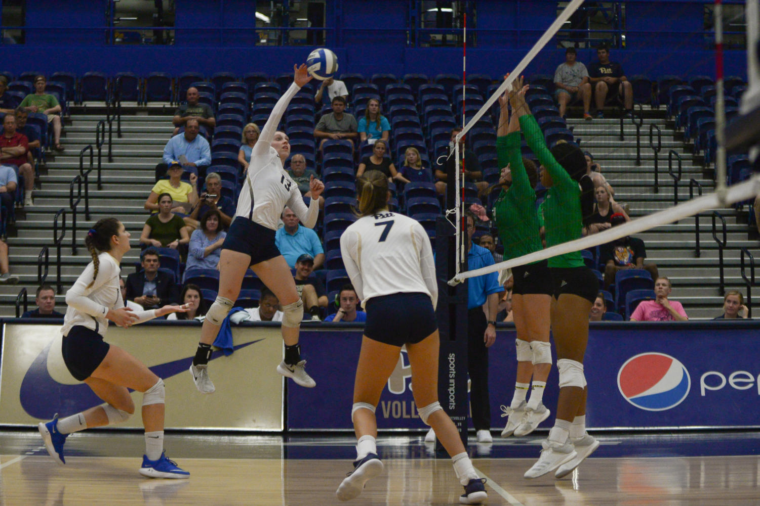 Redshirt junior Stephanie Williams spikes the ball during Pitt's 3-0 victory over North Dakota Tuesday night. (Photo by David Donlick | Staff Photographer)