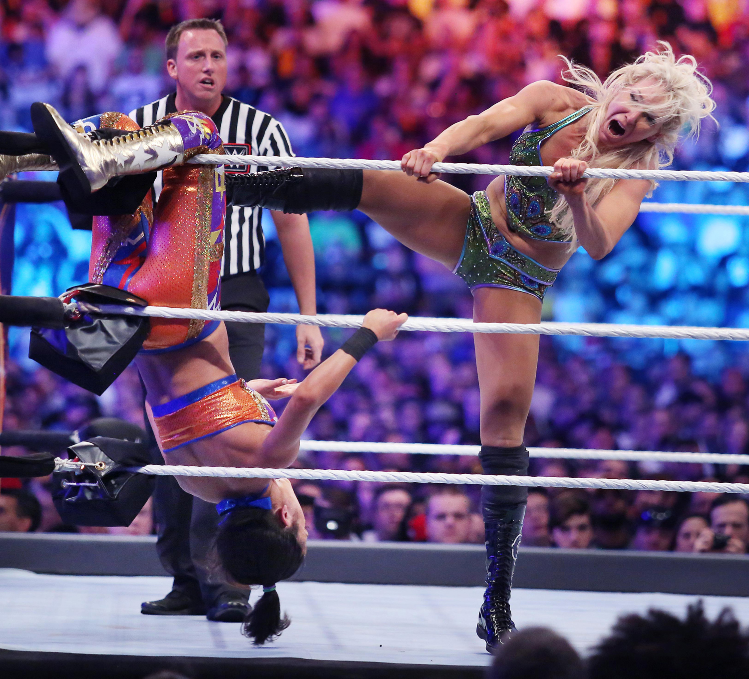 Charlotte Flair (right) kicks Bayley during WrestleMania 33 on April 2, 2017, at Camping World Stadium in Orlando, Florida.