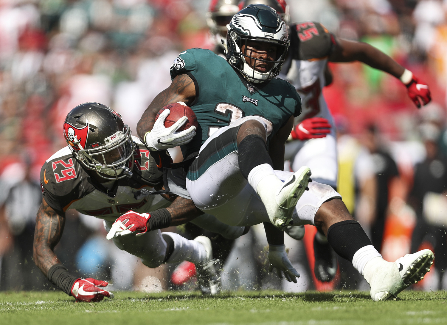 Tampa Bay Buccaneers cornerback Ryan Smith (29) stops Philadelphia Eagles running back Corey Clement (30) on a punt return during the fourth quarter on Sept. 16 at Raymond James Stadium in Tampa, Fla.