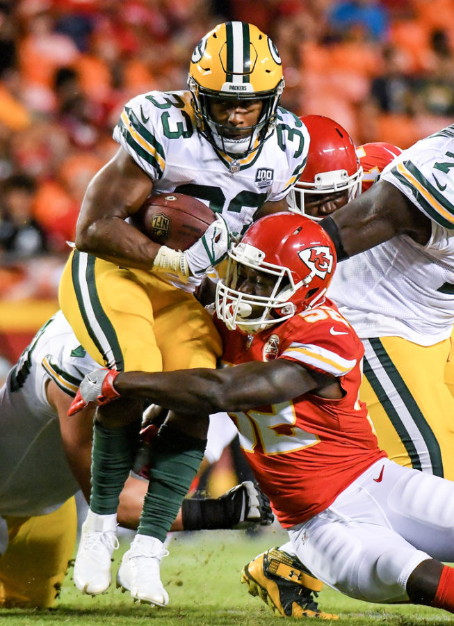 Kansas City Chiefs linebacker Otha Peters wraps up Green Bay Packers running back Aaron Jones in the third quarter during a preseason game on Aug. 30 at Arrowhead Stadium in Kansas City, Mo. The Chiefs won, 33-21.