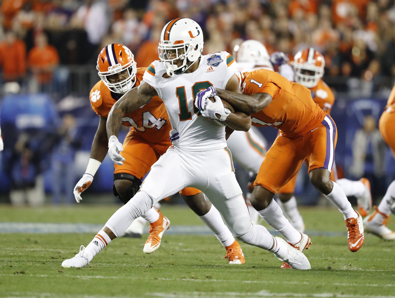 Miami Hurricanes wide receiver Lawrence Cager (18) receives a first down pass in the first quarter as the University of Miami Hurricanes play the Clemson Tigers in the ACC Championship Game on Dec. 2, 2017, in Charlotte, North Carolina.