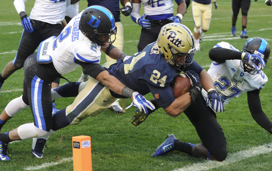 Pittsburgh Panthers then-running back James Conner dives to score a 14-yard touchdown against Duke in the first overtime at Heinz Field on Nov. 1, 2014. Duke won 51-48 in double overtime.  Lake Fong/Pittsburgh Post-Gazette/MCT