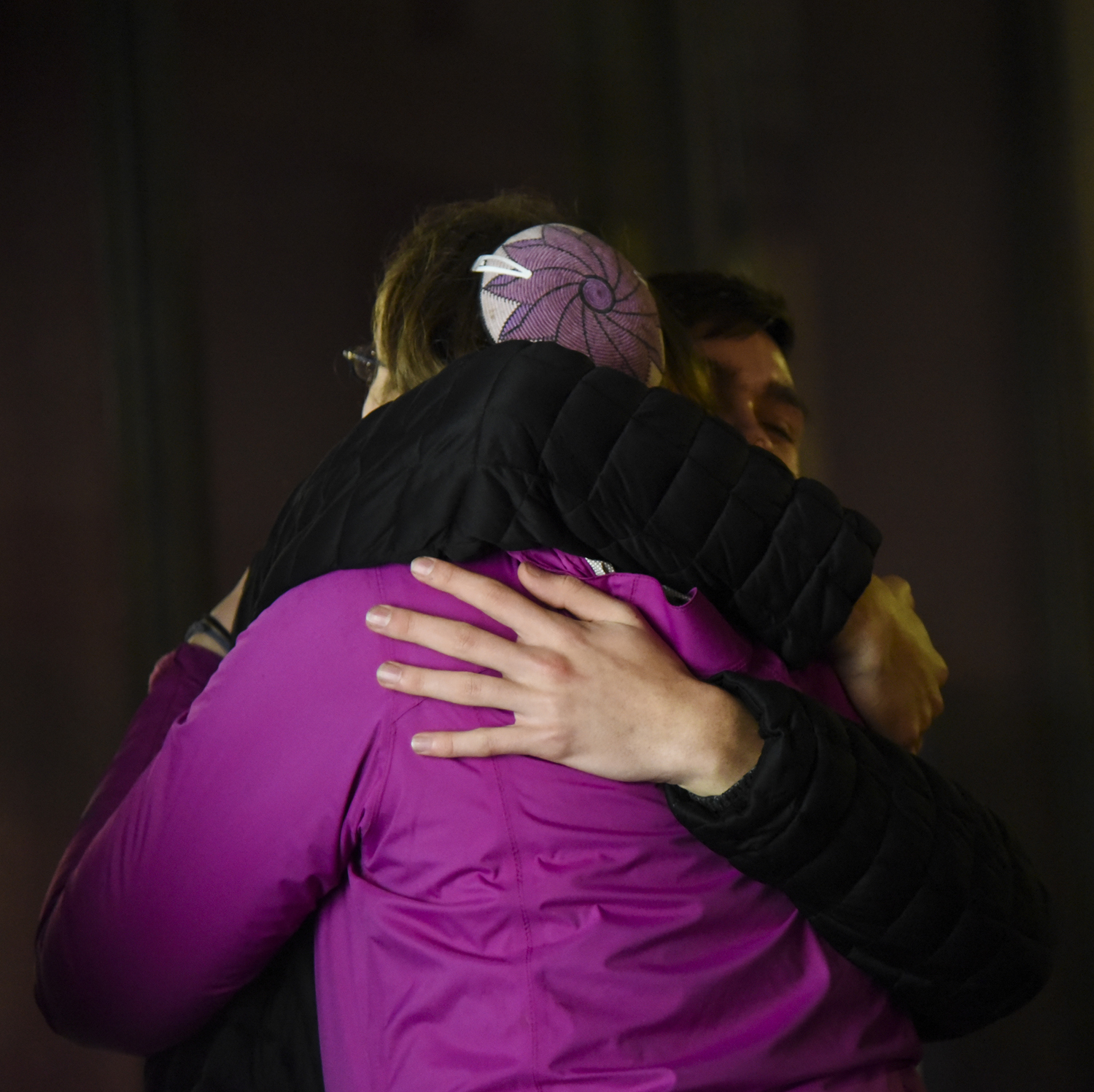 Mourners embrace after the Saturday night vigil for the victims of the shooting at Tree of Life Synagogue ends.