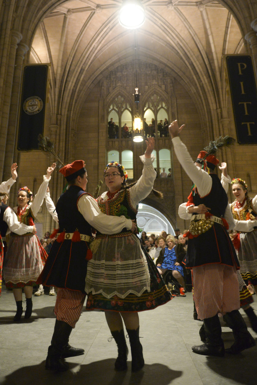 Lajkoniki dancers from Holy Family Catholic Church perform traditional Polish dances during Polishfest in the Cathedral of Learning Commons Room Sunday.
