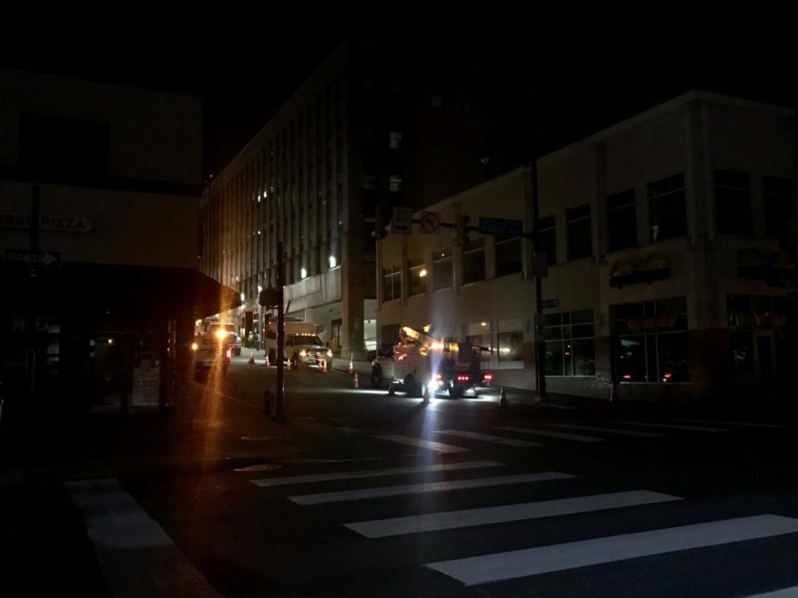 Duquesne+Light+Company+trucks+work+at+the+corner+of+Forbes+and+Atwood+after+midnight+during+a+power+outage+that+carried+over+into+early+Tuesday+morning.