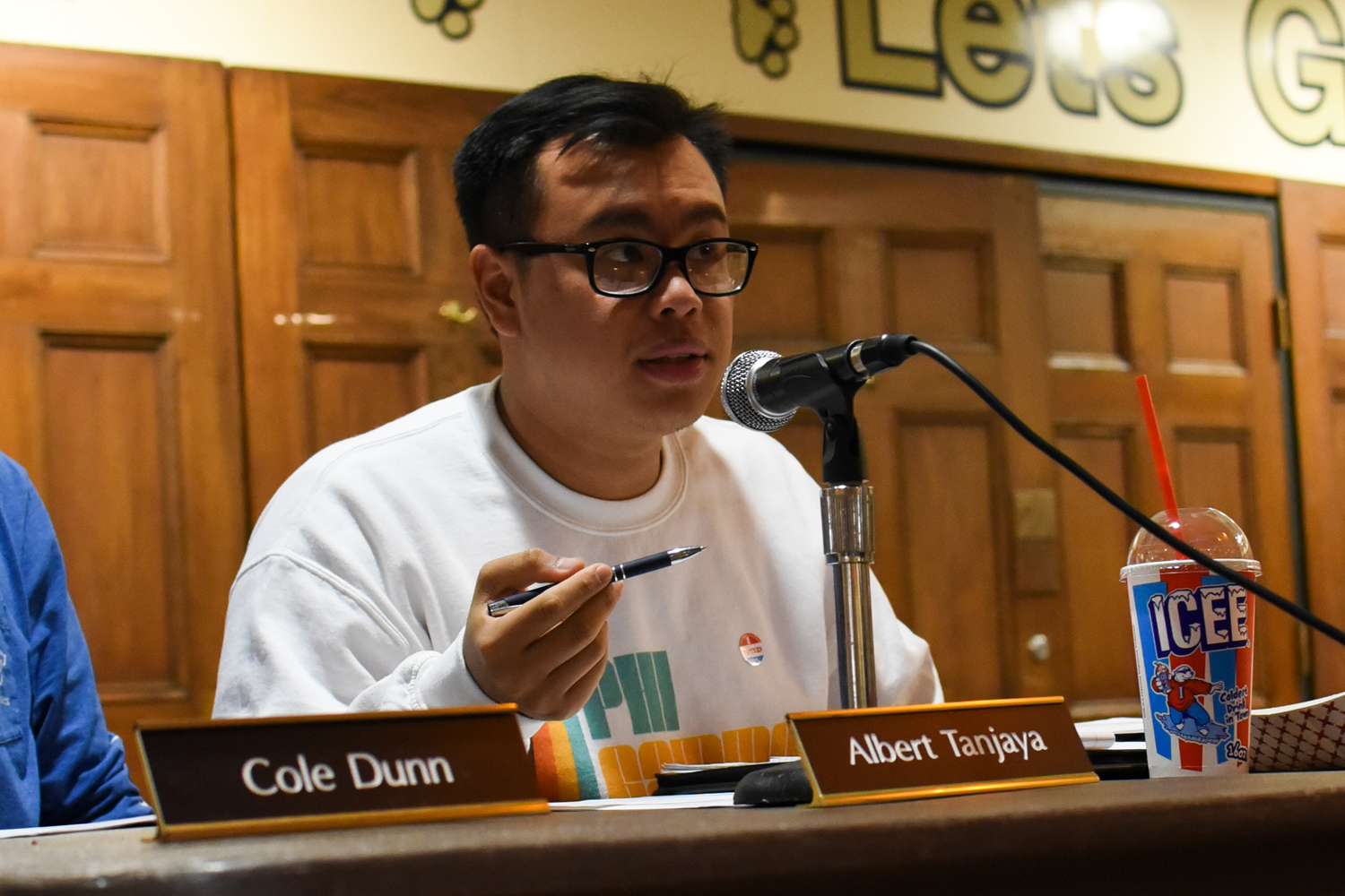 Board member Albert Tanjaya discusses the possibility of adding needle disposal containers to restrooms on campus.