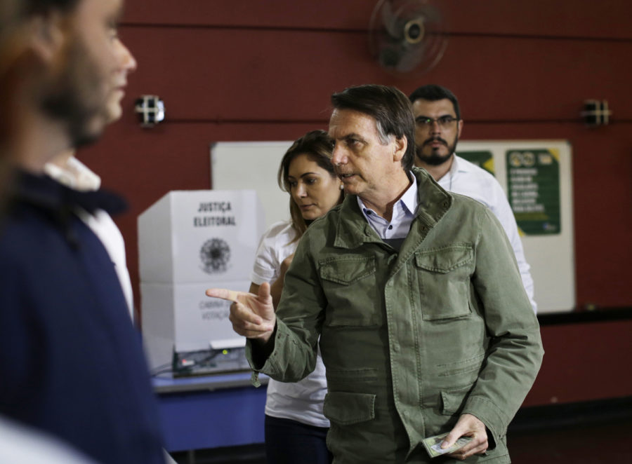 Jair Bolsonaro, ultra-right candidate for the office of Brazilian president, arrives to vote in a polling station on Oct. 28.