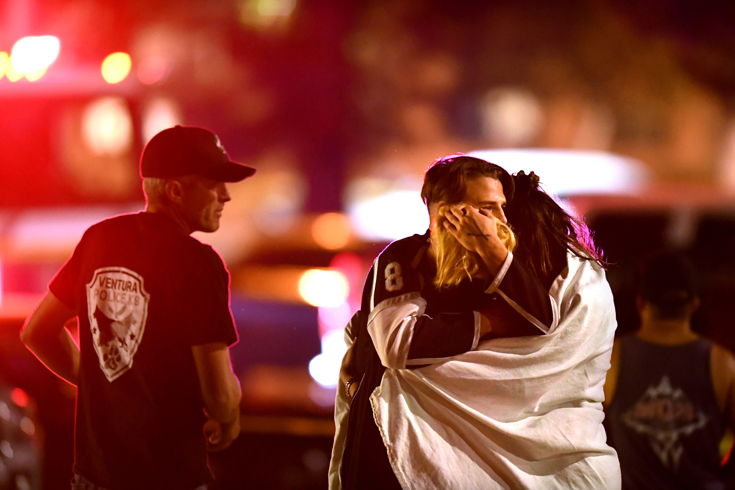 People comfort each other after the mass shooting at Borderline Bar & Grill.