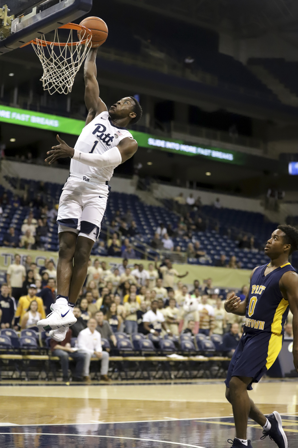 First-year guard Xavier Johnson makes a dunk during Pitt's exhibition game against Pitt Johnstown Thursday evening.