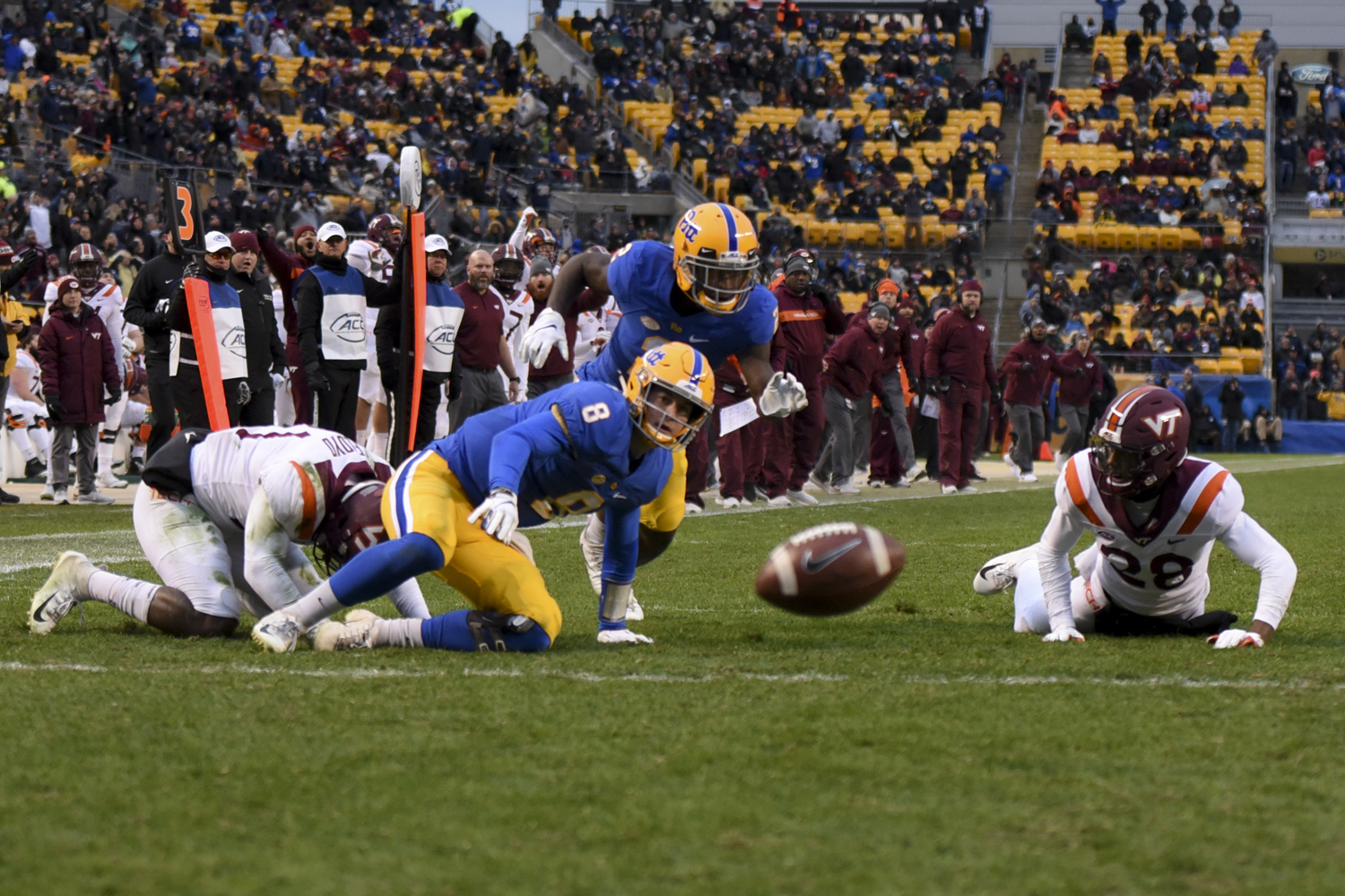 Sophomore quarterback Kenny Pickett fumbles the ball during Pitt's game against Virginia Tech earlier this month.