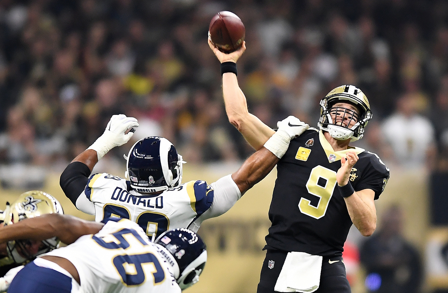 Los Angeles Rams' Aaron Donald gets an arm on New Orleans Saints quarterback Drew Brees (9) on Sunday, Nov. 4, at the Mercedes Benz Superdome in New Orleans.