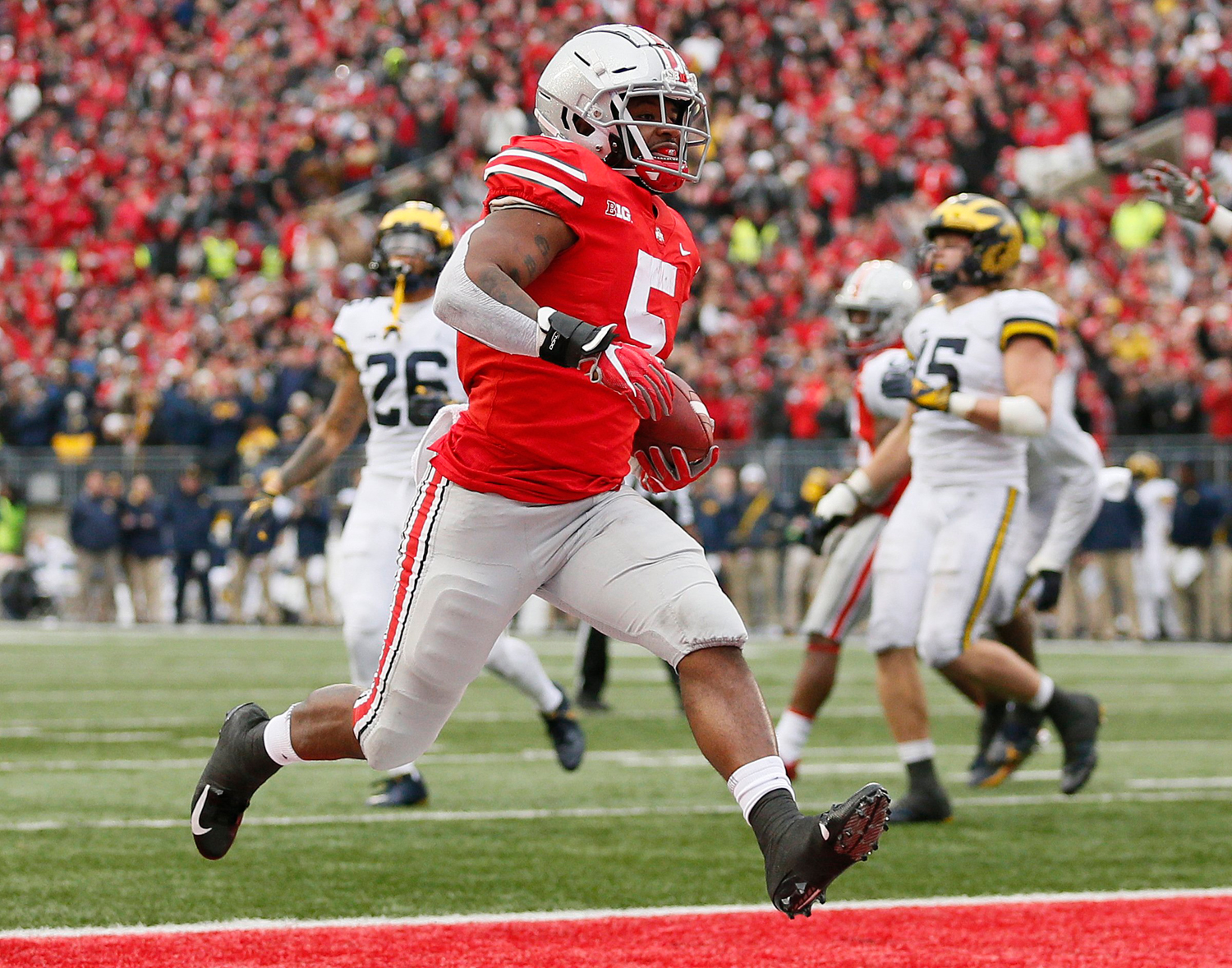 Ohio State running back Mike Weber Jr. (5) scores a rushing touchdown during the third quarter against Michigan on Saturday. Ohio State won, 62-39.