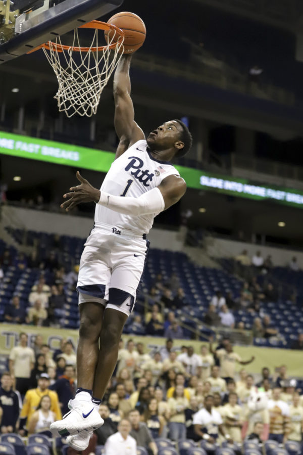 First-year+guard+Xavier+Johnson%2C+pictured+here+in+Pitt%27s+Nov.+1+exhibition%2C+finished+second+on+the+team+with+16+points+against+YSU.
