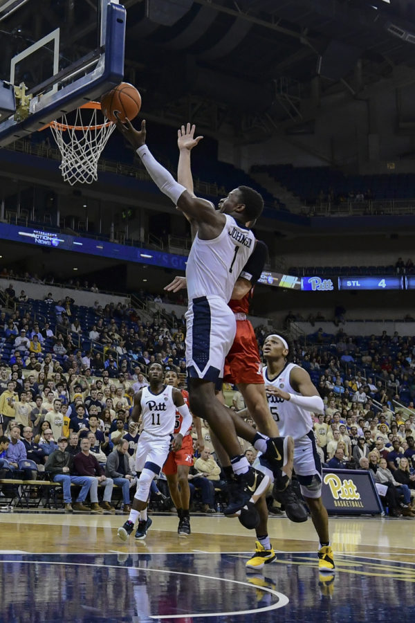 First-year+guard+Xavier+Johnson%2C+pictured+here+against+VMI%2C+extended+his+double-digit+scoring+streak+to+eight+games+in+a+74-53+victory+over+Duquesne.