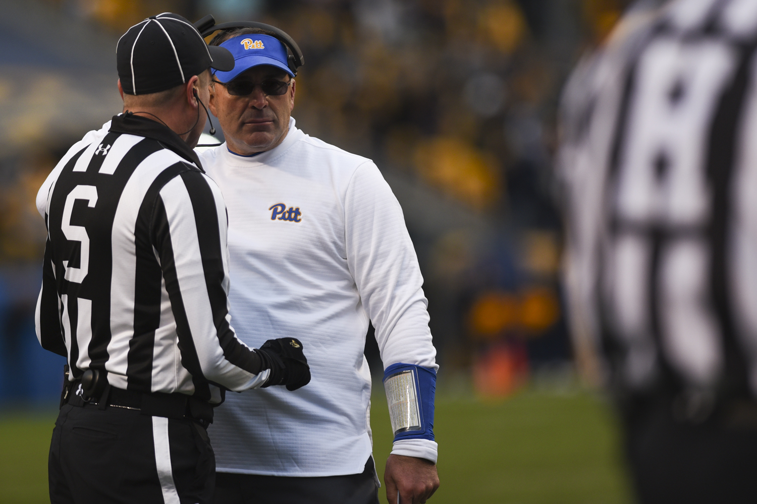 Head coach Pat Narduzzi speaks with a referee during Pitt's last home game earlier this month.