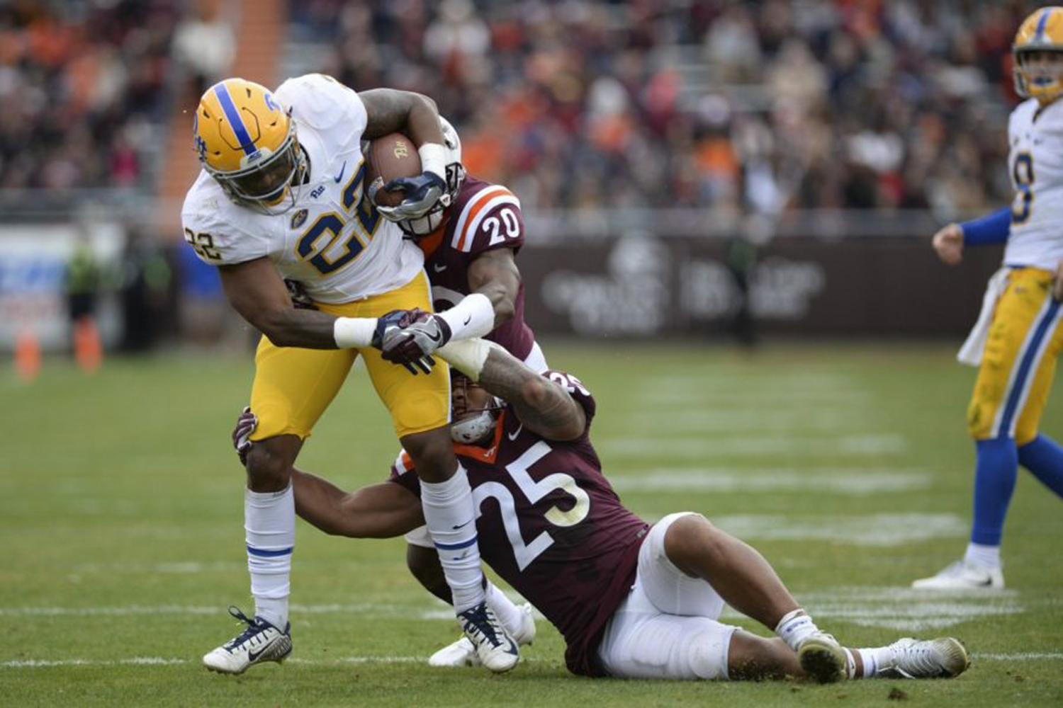 S_What are the Odds: Darrin Hall is taken down by a Virginia Tech player as he runs the ball for Pitt during the teams' 2017 game. TPN file photo
