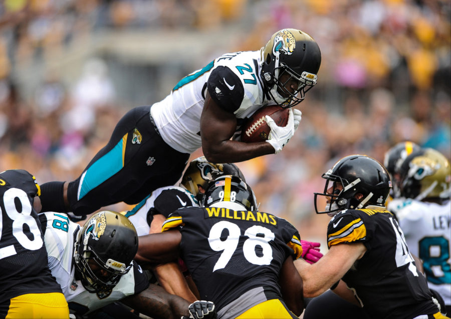 Jacksonville Jaguars running back Leonard Fournette (27) goes over the top against the Pittsburgh Steelers on Oct. 8, 2017, at Heinz Field.