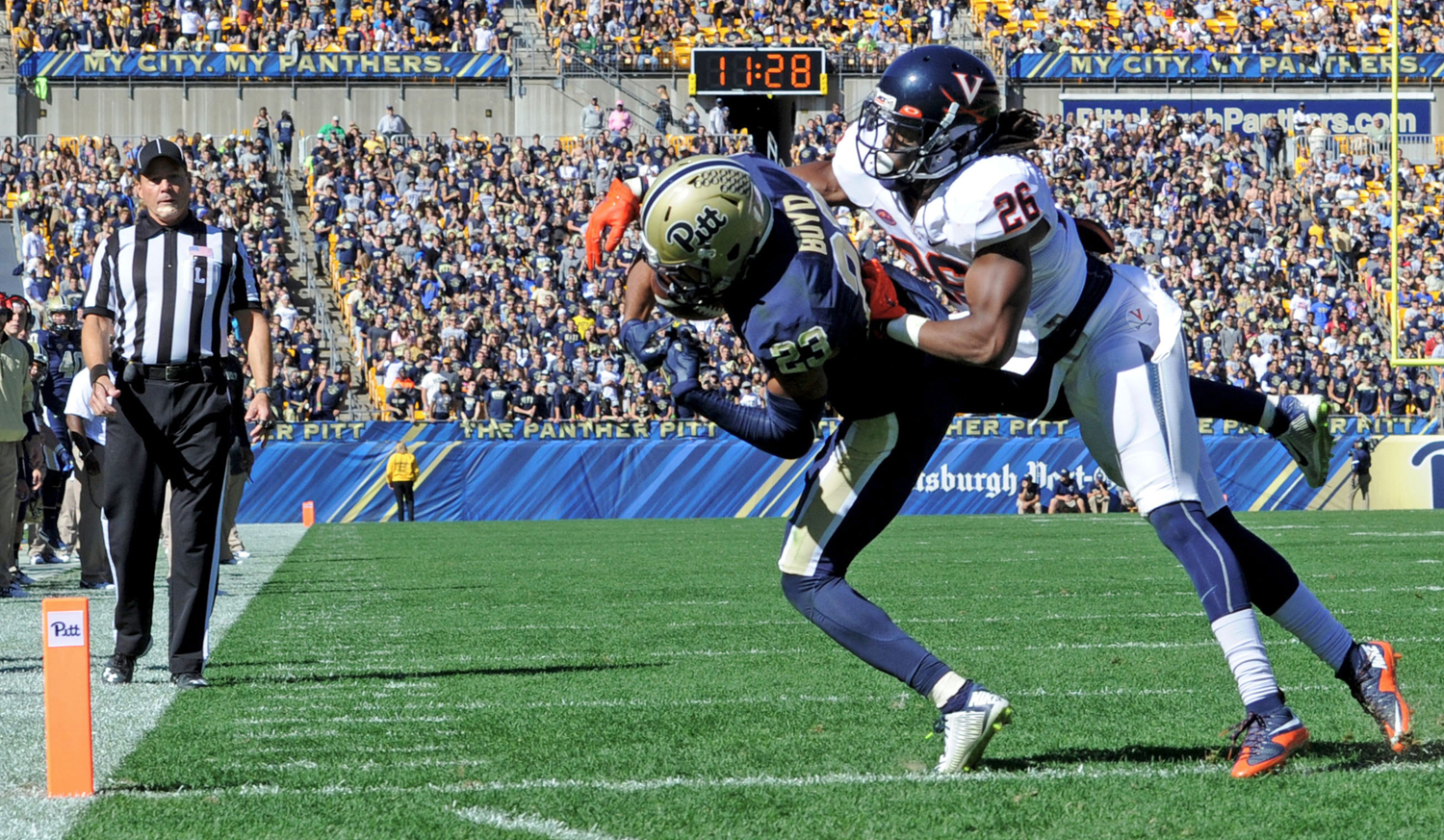 Pitt's then-wide receiver Tyler Boyd pulls in a pass for an 8-yard touchdown as he's defended by Virginia's Maurice Canady in the third quarter on Oct. 10, 2015, at Heinz Field. Pitt won, 26-19.
