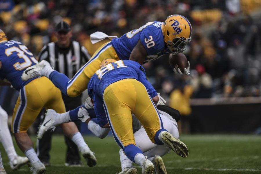 Panthers run wild on Hokies, win 52-22 in Coastal clash