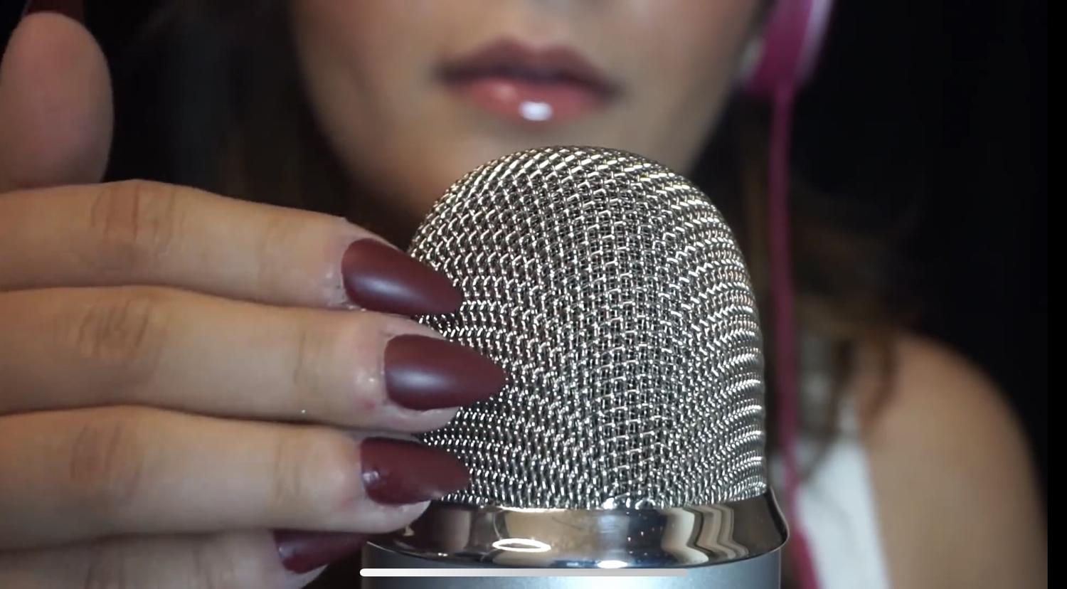 Pittsburgh native Lilliana Dee taps her acrylic nails on a microphone for an ASMR video on her YouTube channel that has more than 200,000 subscribers.