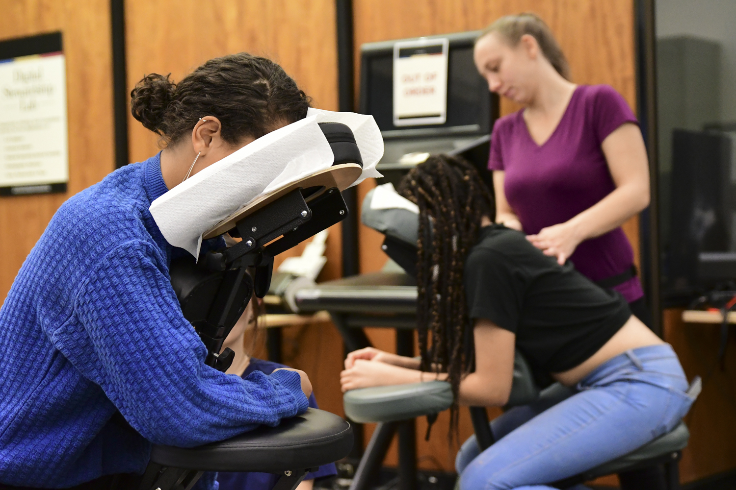 "Junior non-fiction writing and communication double major Abigail Tesfay (left) received a massage from a professional masseuse during Hillman's ""Long Night Against Procrastination"" event Monday night."