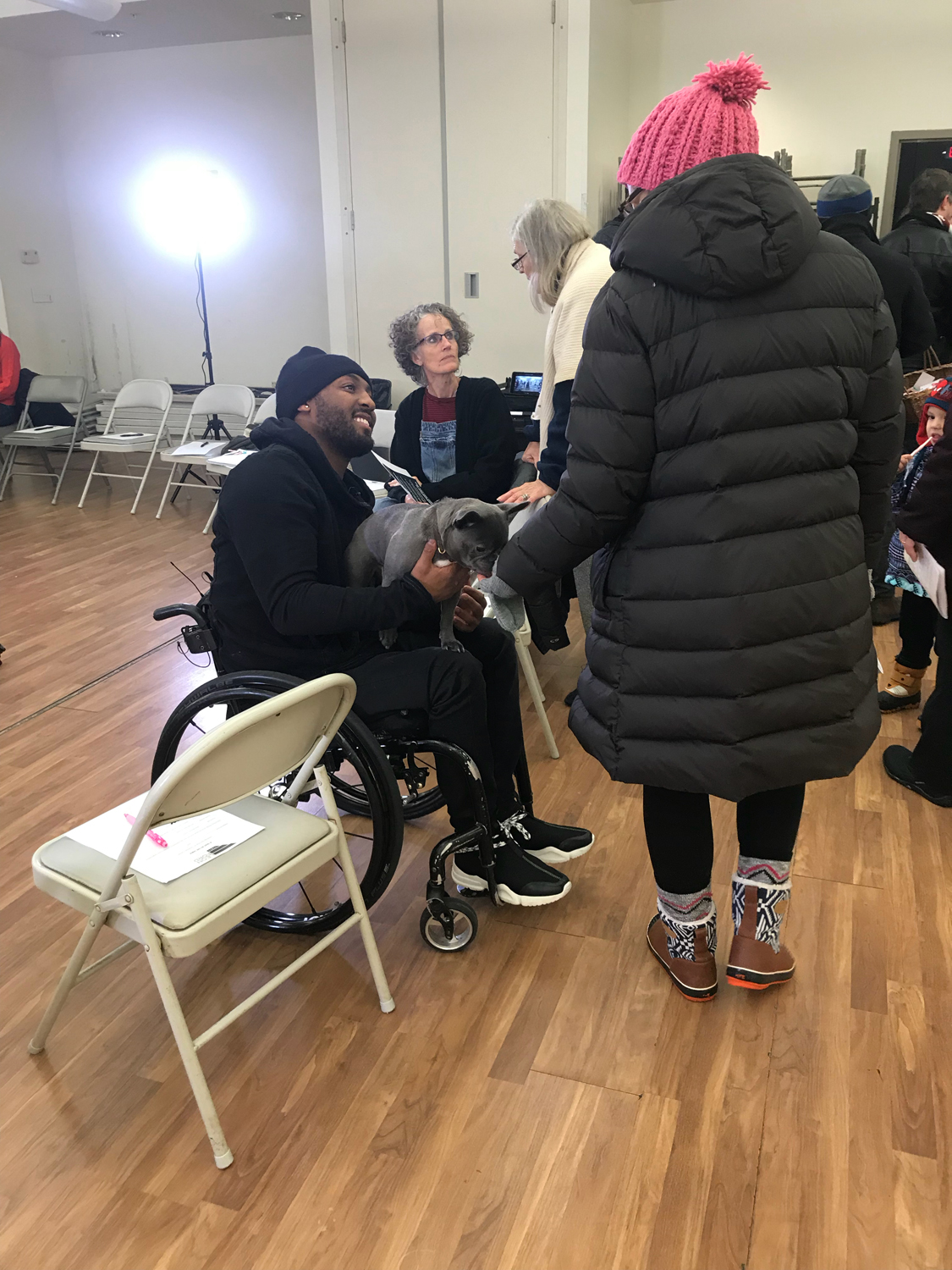 "Leon Ford (left) speaks with East Liberty community members at his campaign's ""A Seat at the Table"" event Wednesday evening. Ford plans to run for the Pittsburgh city council's ninth district seat on platform centered around community engagement."