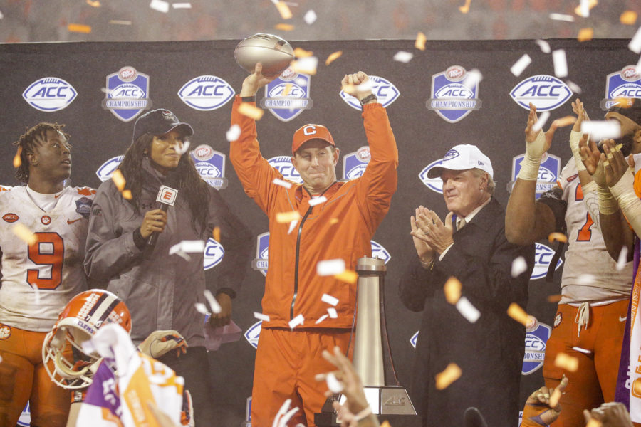 Clemson+head+coach+Dabo+Swinney+celebrates+the+team%E2%80%99s+victory+over+Pitt+with+the+ACC+Championship+trophy+in+his+hand.+