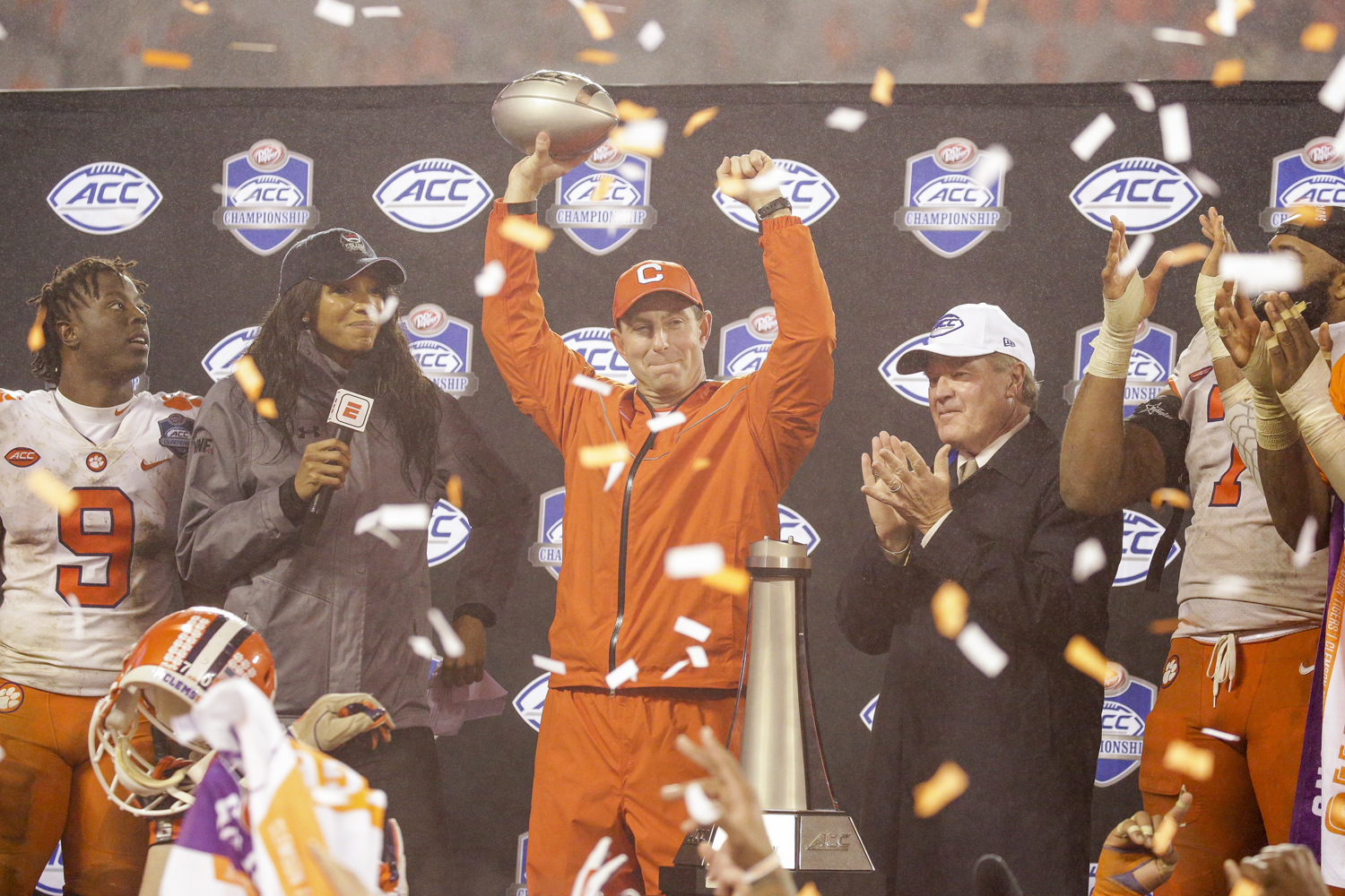 Clemson head coach Dabo Swinney celebrates the team's victory over Pitt with the ACC Championship trophy in his hand.