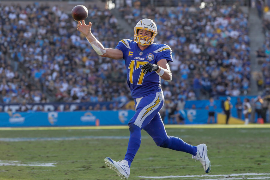 Los+Angeles+Chargers+quarterback+Philip+Rivers+rolls+out+to+throw+a+4-yard+touchdown+pass+to+Keenan+Allen+in+the+third+quarter+against+the+Arizona+Cardinals+on+Nov.+25.