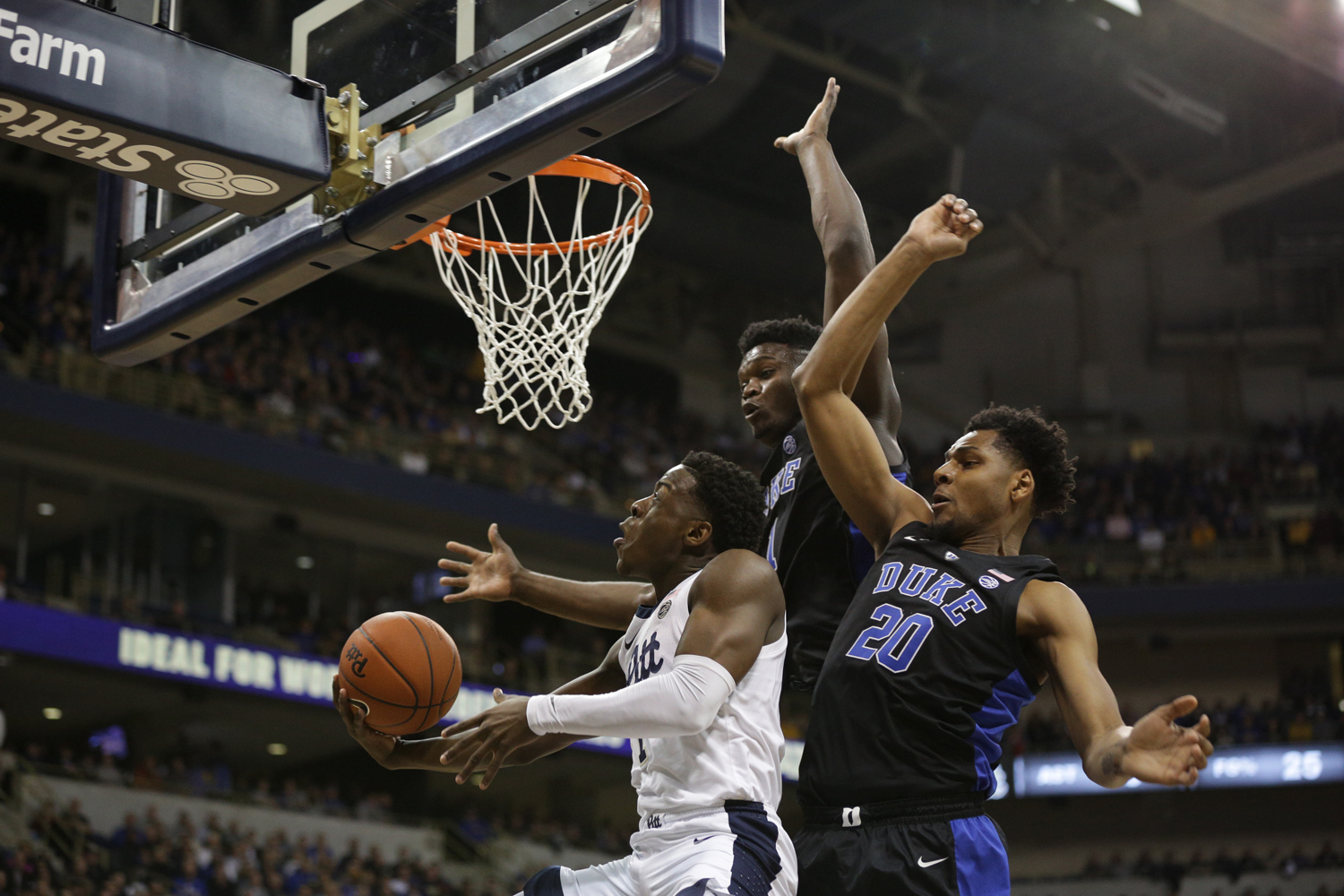 First-year guard Xavier Johnson (1), pictured here vs. Duke, was held to single-digit points for the second straight game against Louisville.