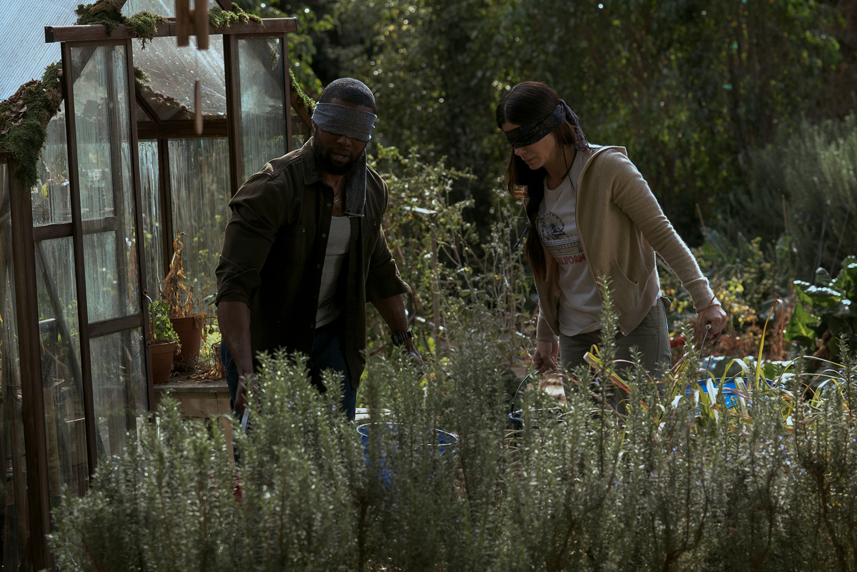 "Trevante Rhodes and Sandra Bullock in ""Bird Box."""