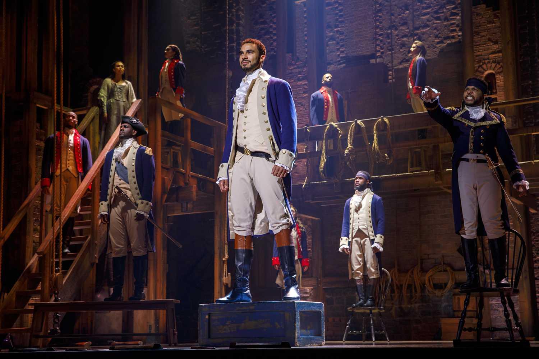 Actor Austin Scott (center) takes the titular role of Alexander Hamilton in the musical Hamilton.