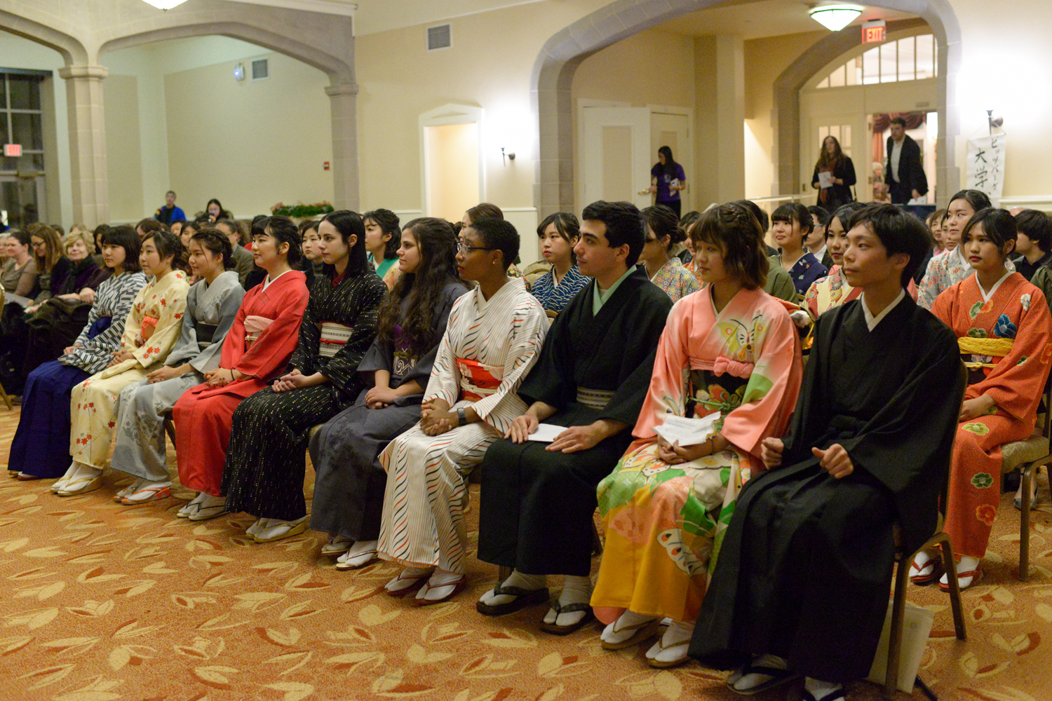 Students from Yasuda Women's University and University of Pittsburgh take their seats before Friday afternoon's Coming of Age Day ceremony.