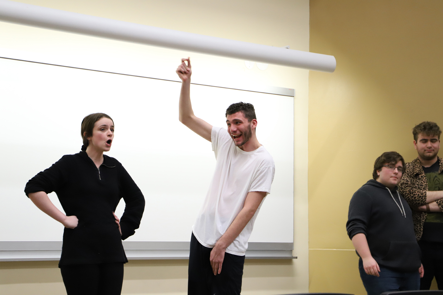 Two Ruckus members, sophomores Clare Donaher and Patrick Meyer, perform their routine that revolves around rotating troupe members in and out in the middle of skits.
