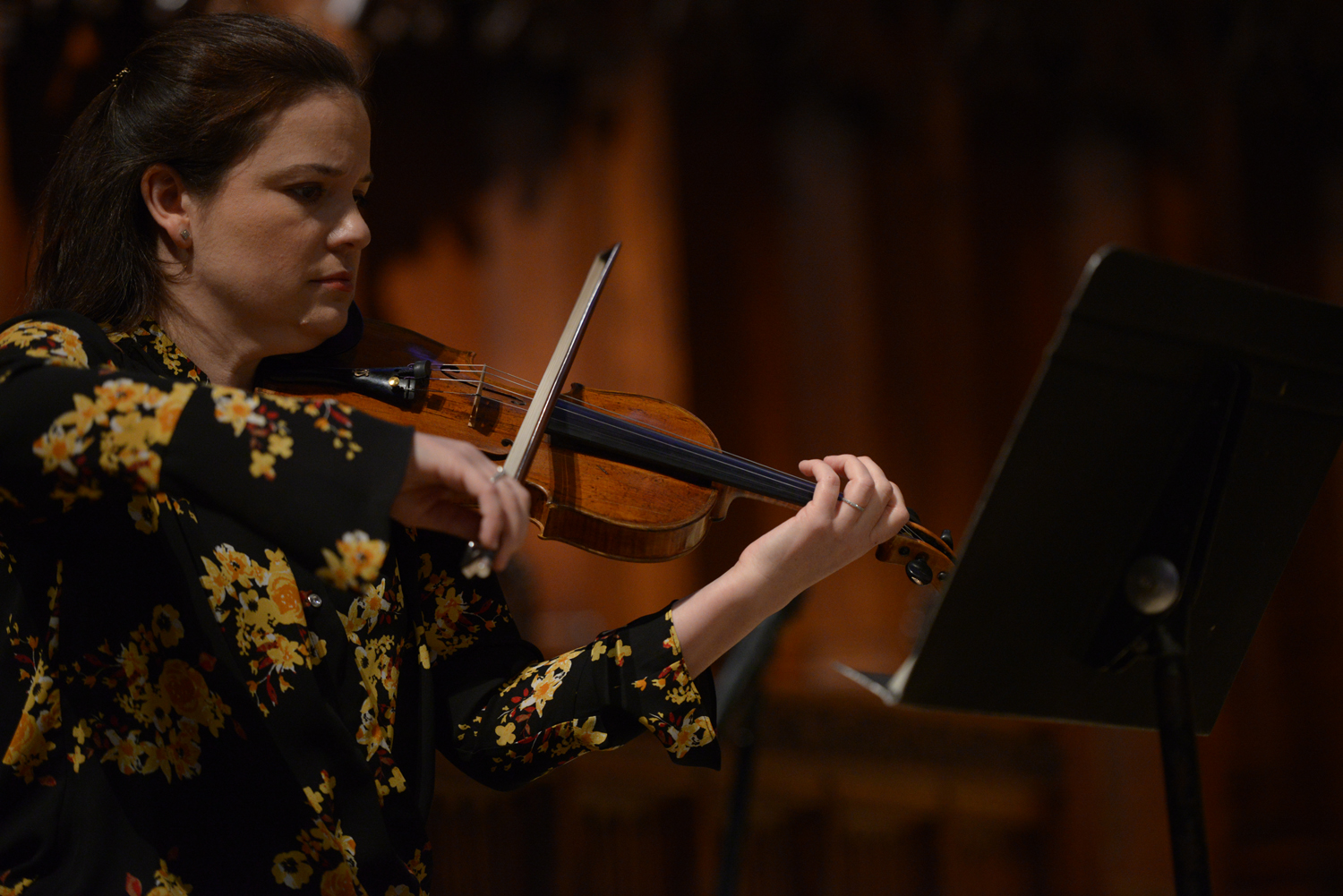 Lydia Miller plays the violin in Heinz Chapel as one-third of the Miller-Kufchak-DeBruyn Trio.
