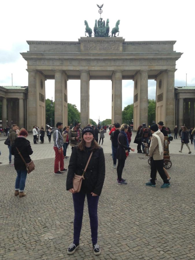 Senior Staff Writer Maggie Koontz stands in front of the Brandenburg gate in Berlin.