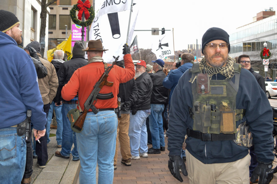 Many+of+the+protestors+gathered+outside+the+City-Council+Building+carried+firearms+during+Monday+afternoon%E2%80%99s+demonstration.%0A