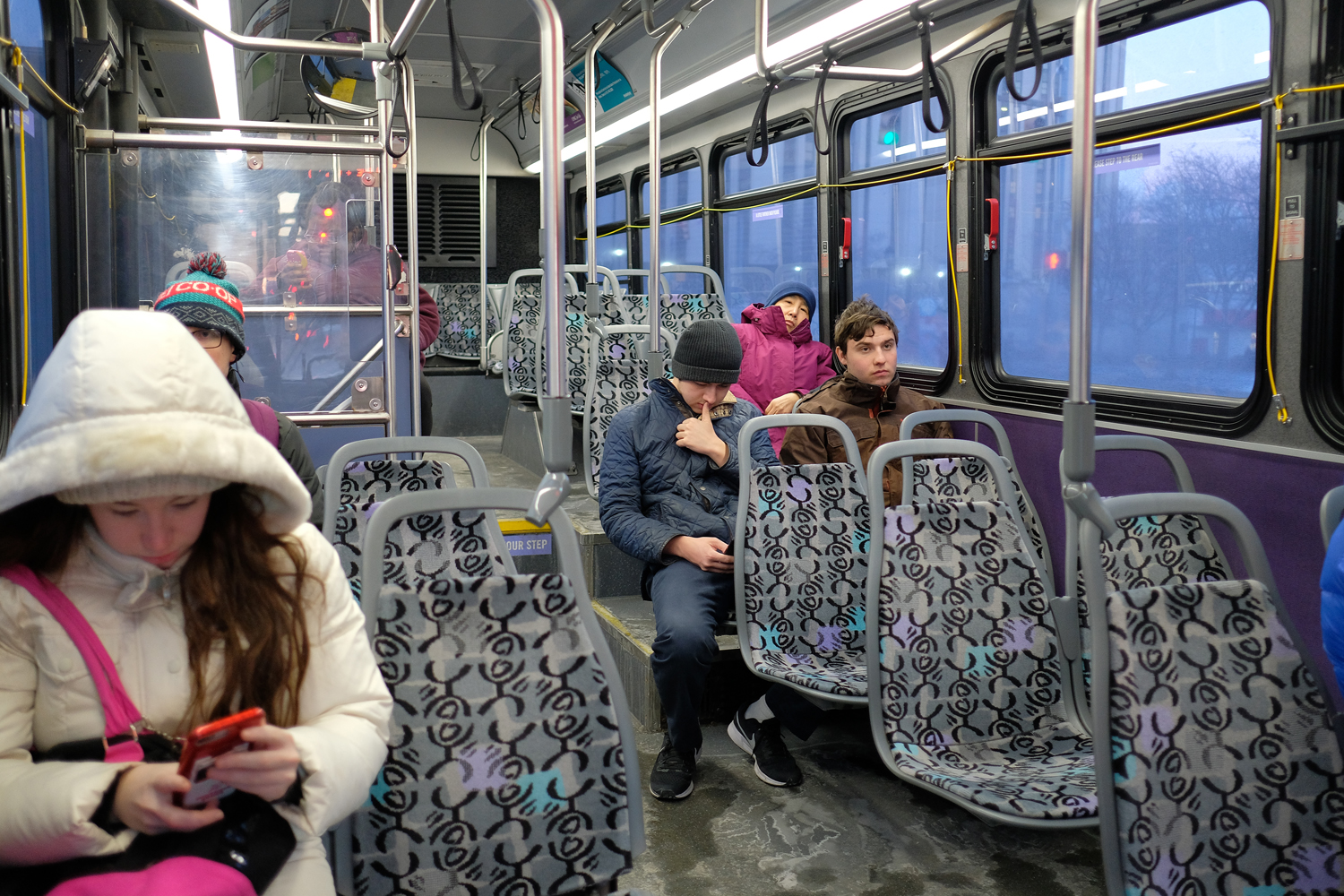 The interior of a Port Authority bus traveling along Fifth Avenue.
