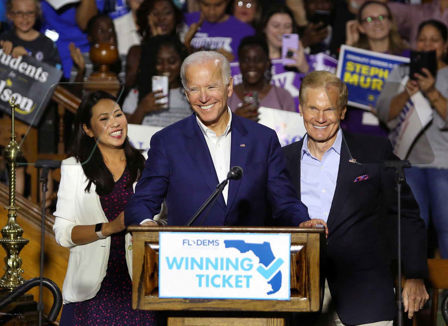 From left, Rep. Stephanie Murphy, former Vice President Joe Biden and Sen. Bill Nelson respond to cheering supporters as Biden headlined a rally for Democrats in downtown Orlando, on Tuesday, Oct. 23, 2018.