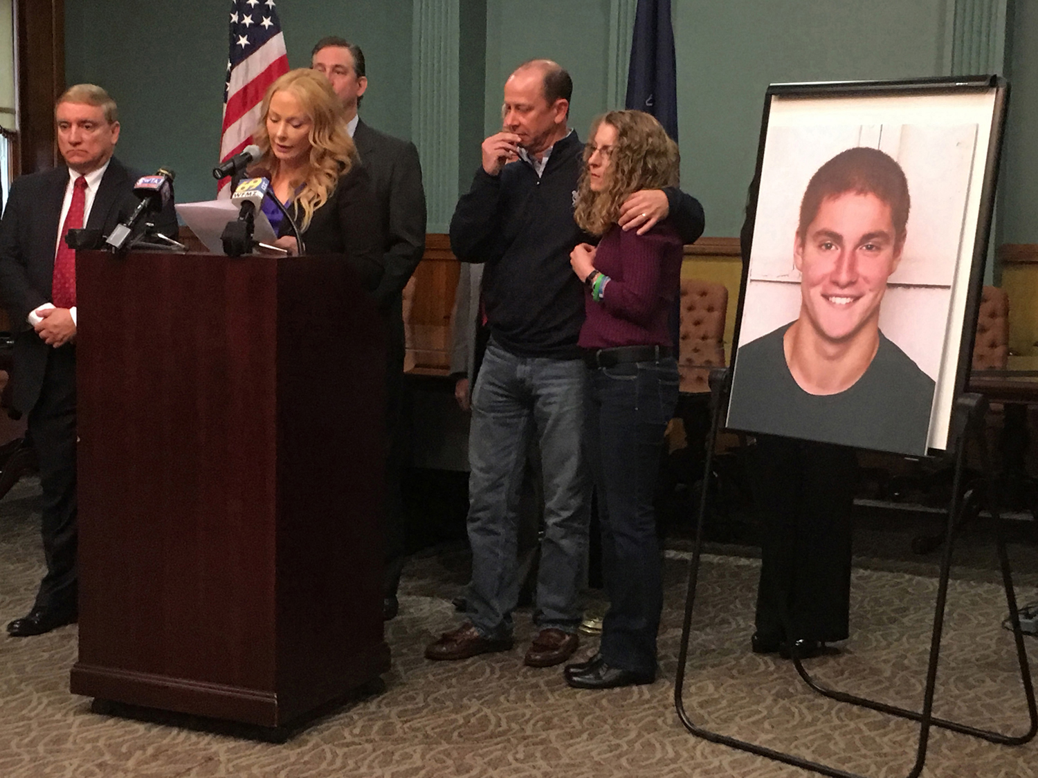 Stacy Parks Miller, former Centre County district attorney, with James and Evelyn Piazza, parents of Timothy Piazza, 19, of Readington Township, New Jersey, during a news conference at the Bellefonte courthouse.