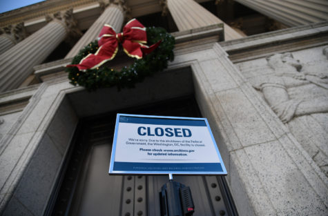 A sign announcing closure of the National Archives due to a partial government shutdown is displayed on Dec. 24, 2018, in Washington, D.C.