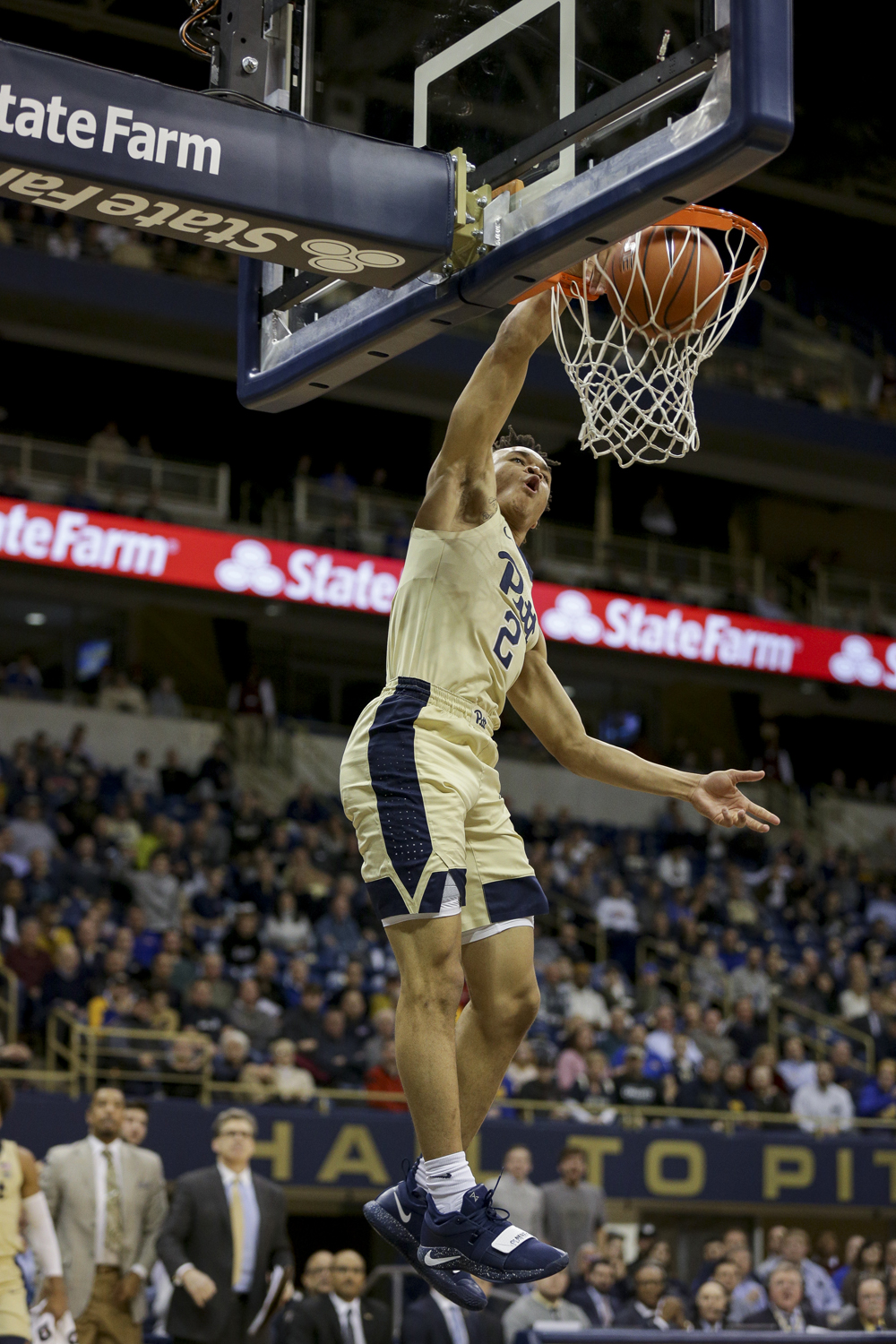 First-year guard Trey McGowens (02) completes a dunk during Pitt's 89-86 victory of Louisville Wednesday evening.